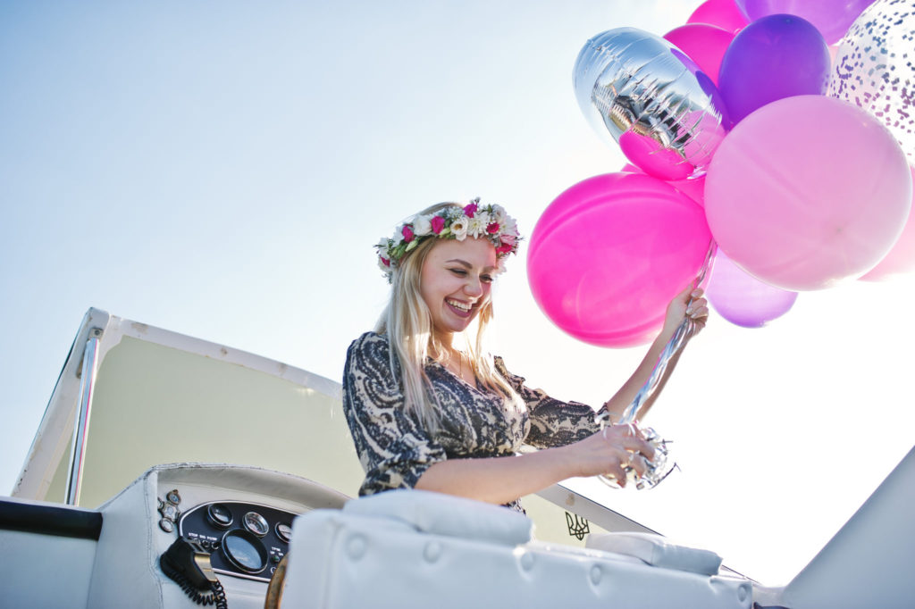 blonde-girl-wreath-sitting-yacht-hen-party