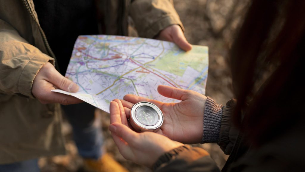 close-up-travelers-with-map-compass