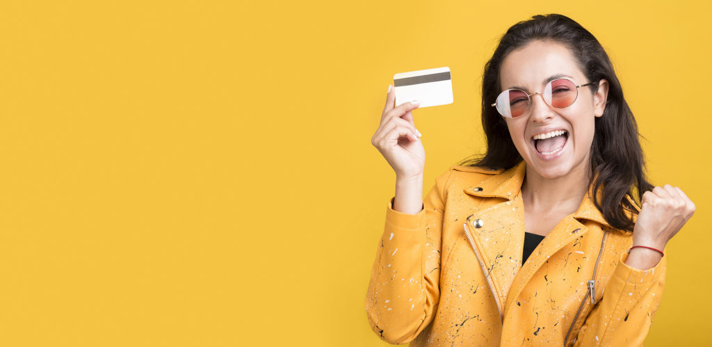 woman-yellow-jacket-holding-credit-card-copy-space