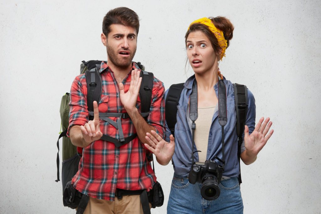 emotional-bearded-guy-beautiful-woman-with-professional-camera-gesturing-with-both-hands-making-stop-sign-expressing-denial-reject-unwillingness-human-emotions-feelings